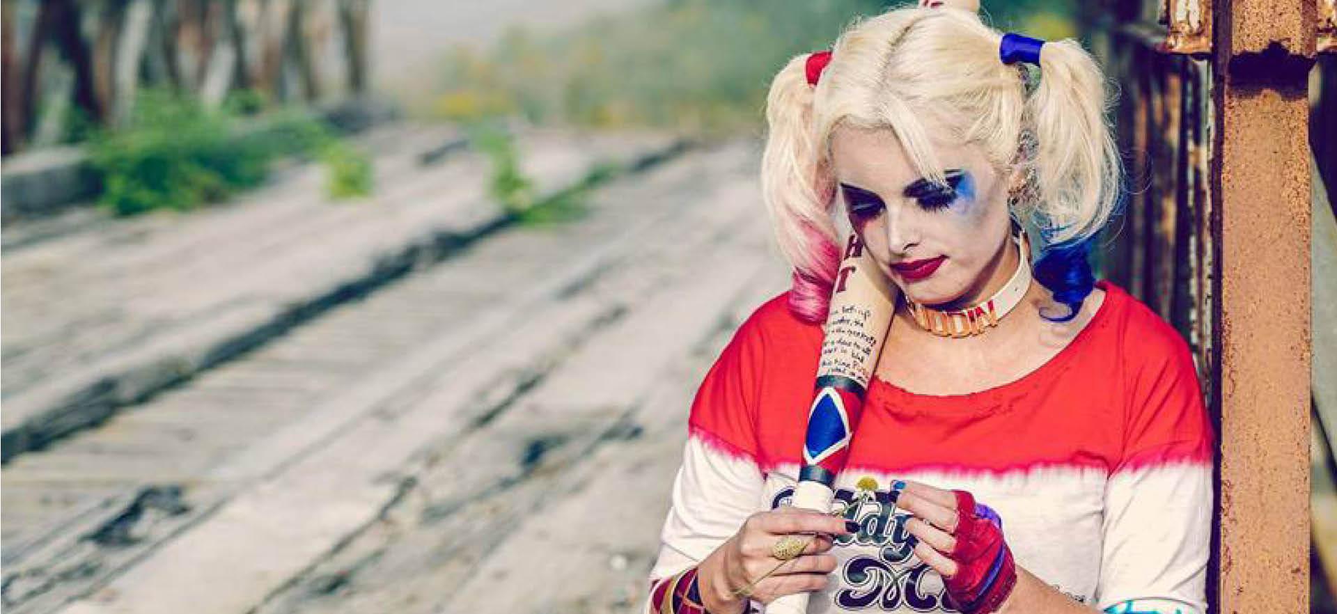 Harley Quinn cosplayer holding flower